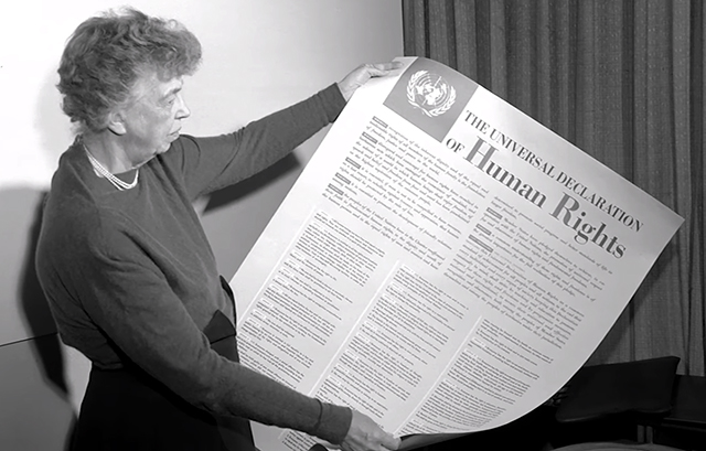 December 10, 1948: United Nations adopts Universal Declaration of Human Rights. Anna Eleanor Roosevelt, longest-serving First Lady of the United States and Chair of the UN Human Rights Commission, holds the historic Universal Declaration of Human Rights, which includes Franklin Roosevelt's Four Freedoms.