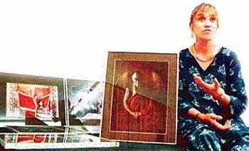 Diane Barker with some of her photographs